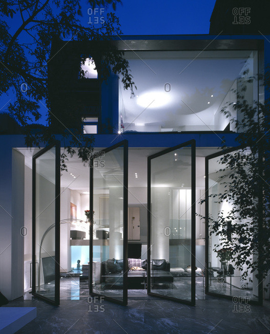London, England - October 1, 2002: Rear of a refurbished modern house with an open glass wall