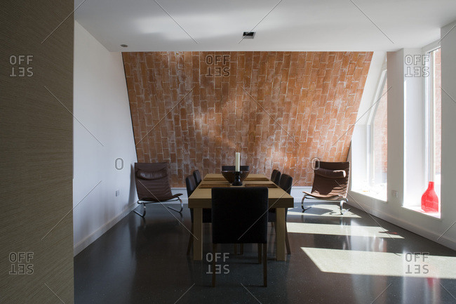 Dining room with exposed brick wall in a zero carbon house
