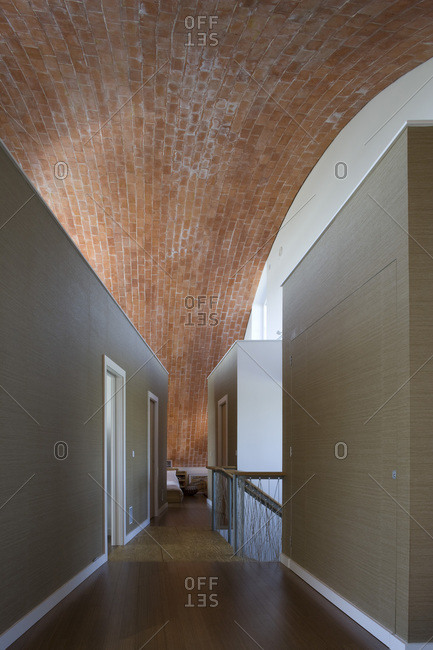 Hallway with an exposed brick ceiling in a zero carbon house