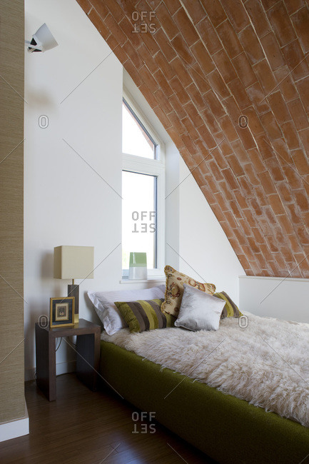 Bedroom with an exposed brick ceiling in a zero carbon house