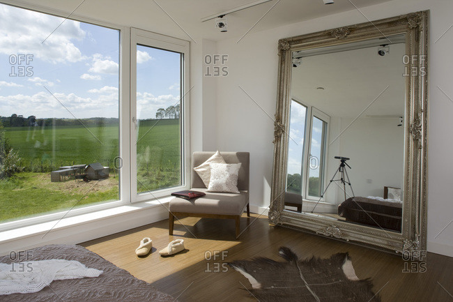 Larger mirror and chair in a bedroom in a zero carbon house