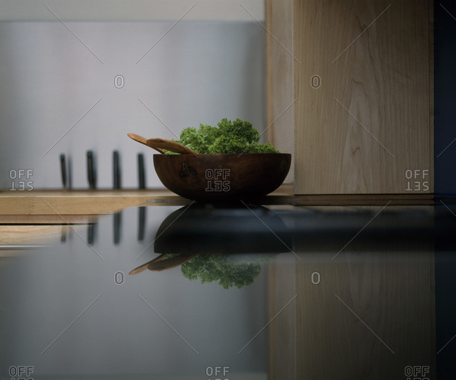 Kitchen counter top with bowl of salad