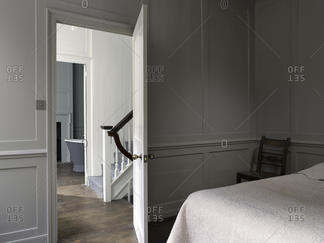 View across bedroom to bathroom in a renovated Georgian townhouse