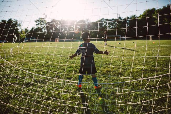 A goalie prepares to defend the goal