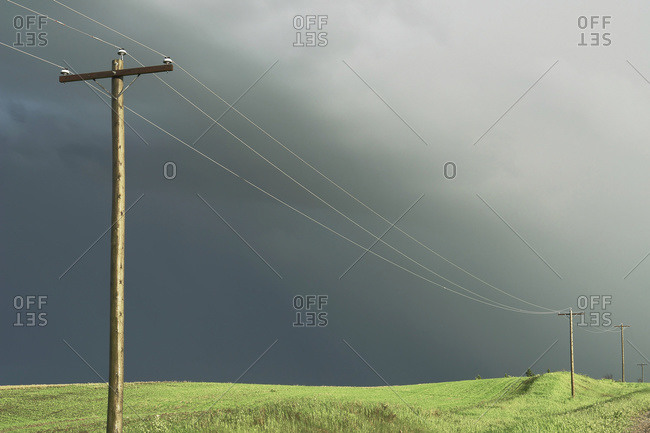 Stormy Sky And Sunlight On Hydro-Electric Power Lines, Rural Manitoba, Canada