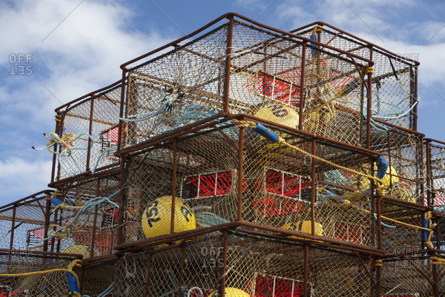 Stack Of Crab Pots Rigged With Orange Triggers For Pacific Cod Fishery And Stored Near Pier One In The City Of Kodiak, Kodiak Island, Southwest Alaska, Fall