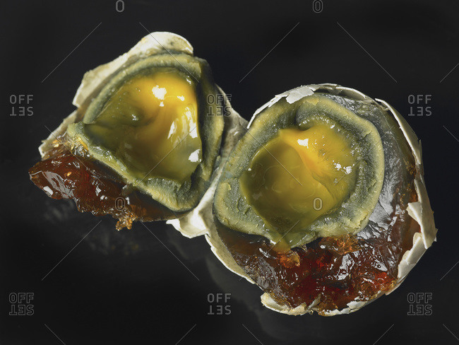 Open eggs on a black background