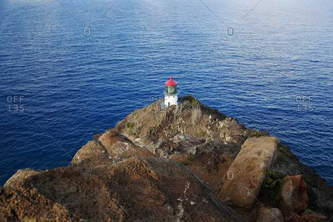 Makapuu Lighthouse on rocky cliff overlooking ocean, Oahu, Hawaii, United States of America