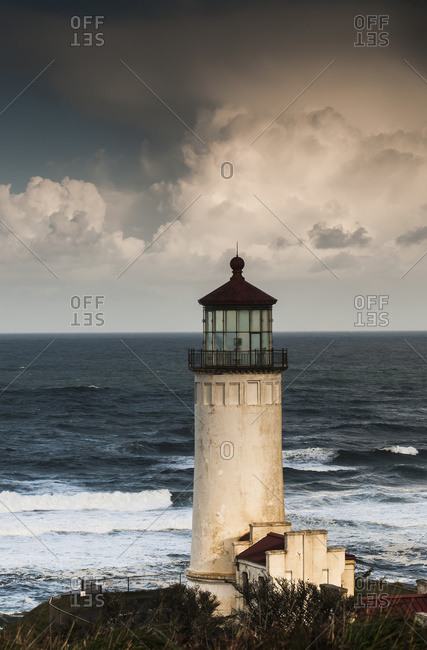 North Head Lighthouse complemented by clouds and surf, IL Waco, Washington, United States of America