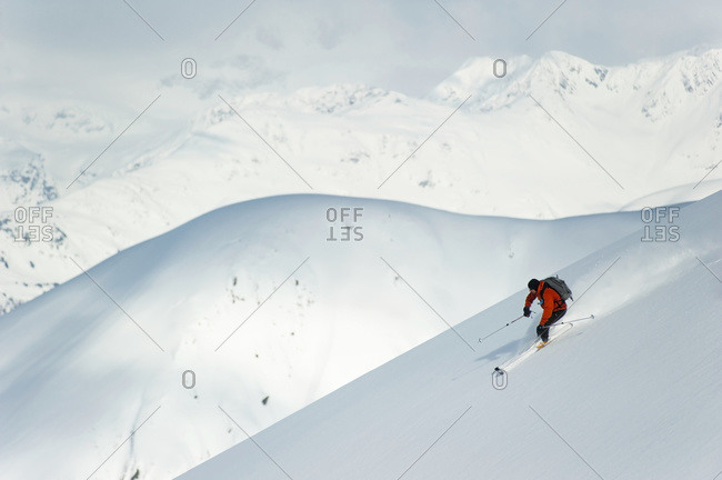 Man skiing the west face of Peak 3720, Turnagain Arm, Chugach Mountains, South-central Alaska