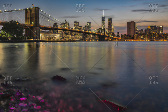 Lower Manhattan at twilight with the Brooklyn Bridge, Brooklyn Bridge Park, Brooklyn, New York, United States of America