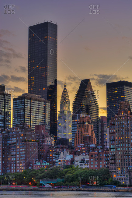 New York City, New York, United States of America - August 18, 2014: Midtown Manhattan skyline with Chrysler Building at sunset as viewed from Roosevelt Island, New York City, New York, United States of America