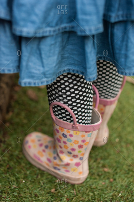 A girl in pink rain boots