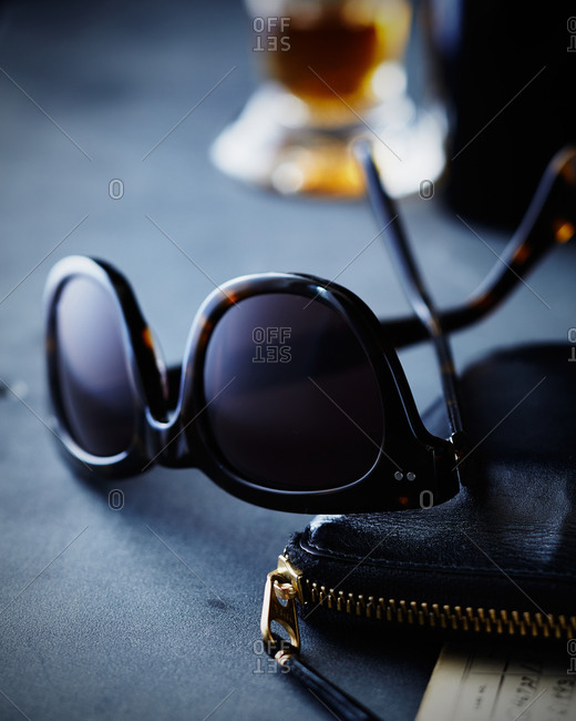 Sunglasses on a zippered wallet