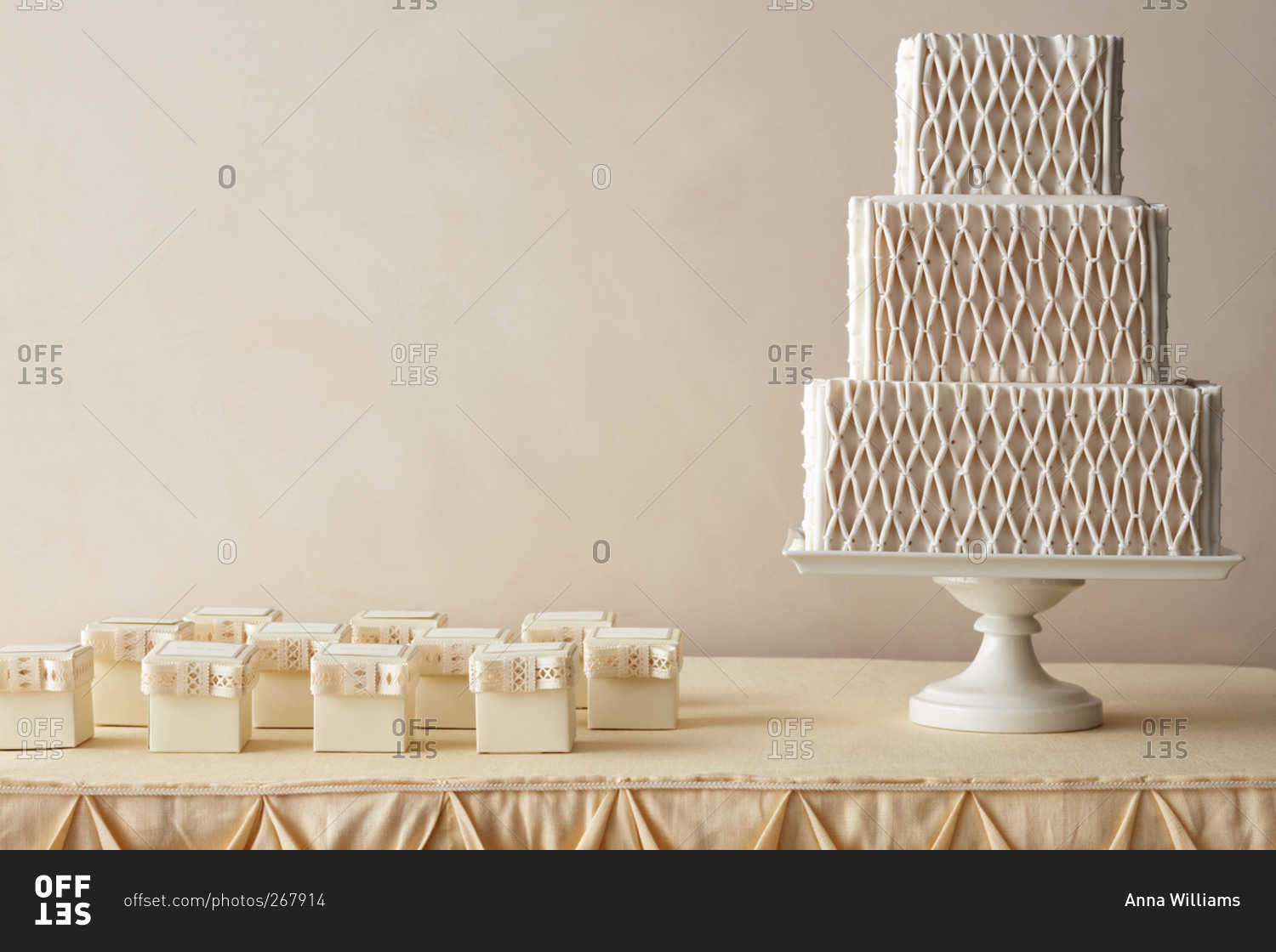 Quilted diamond pattern wedding cake and party favors stock photo ...