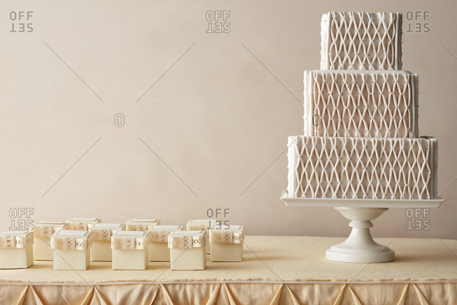 Quilted diamond pattern wedding cake and party favors