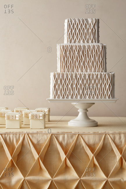 Three-tiered wedding cake with quilted diamond pattern