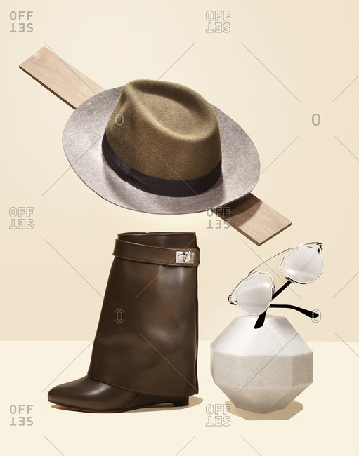 An arrangement of a shoe and fedora