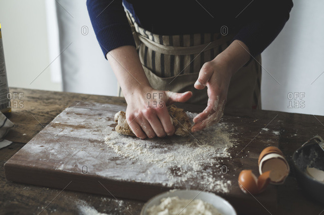 Woman kneading homemade pasta dough