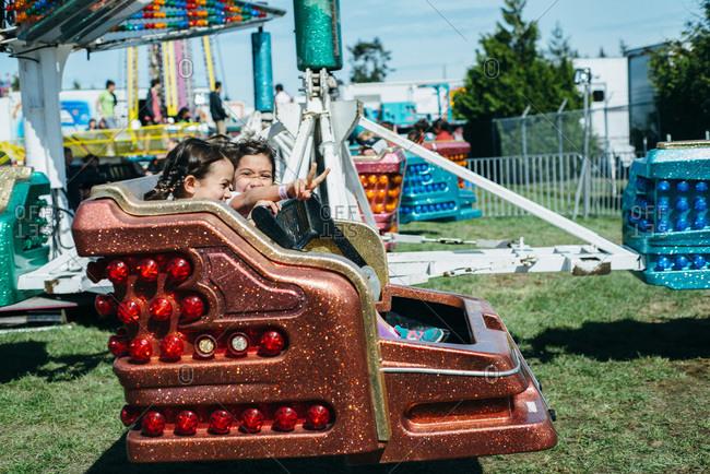 Children on an amusement ride at a fair