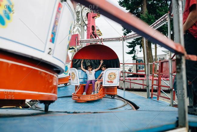 Children on a ride at a fair