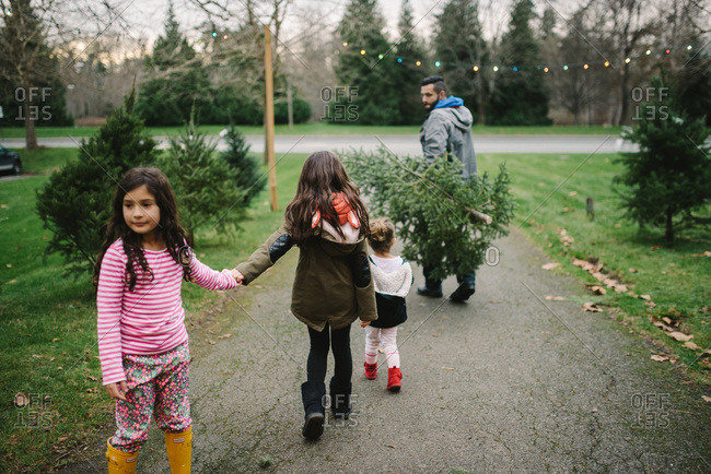Father and Children buying a Christmas tree