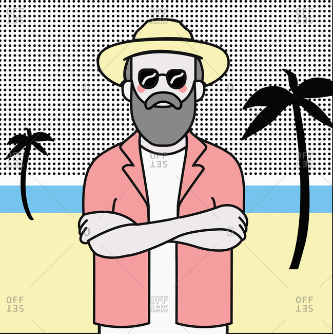Bearded man with sunglasses and hat standing with arms crossed on beach with palm trees
