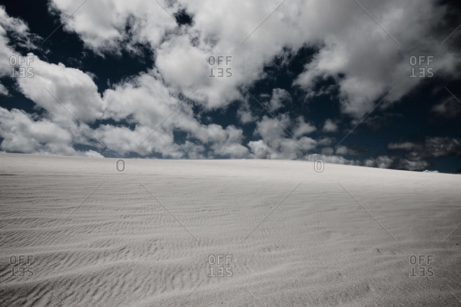 White sand and fluffy clouds