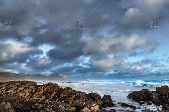 A rocky coast at dusk