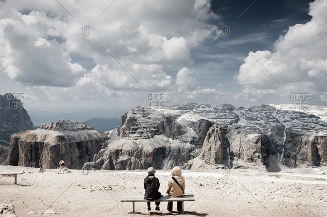 Hikers enjoy the view of rocky mountains