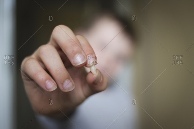 Little boy's hand showing tooth