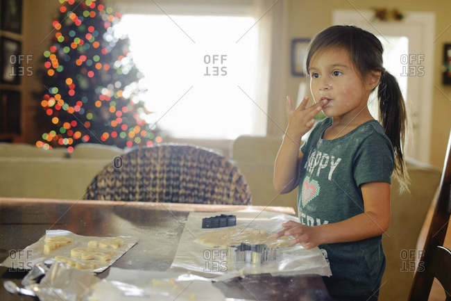 Young girl making cookies at Christmastime