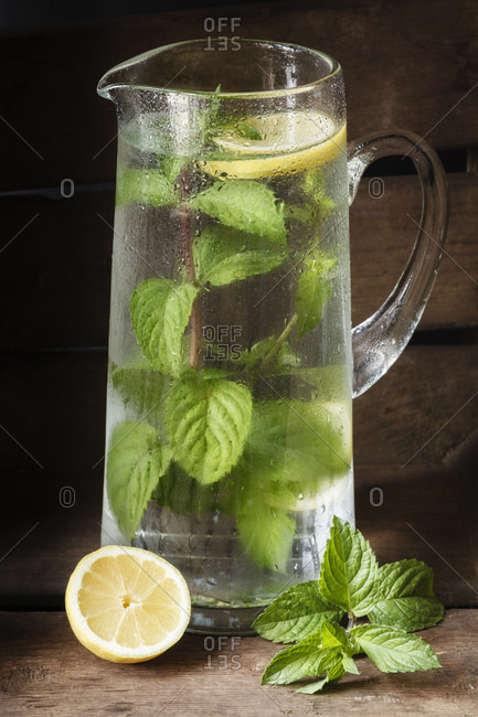 Carafe with water, mint and lemon, flavored