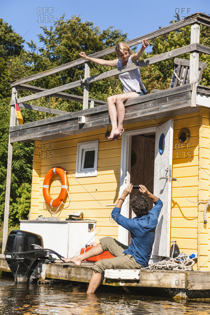 Couple having a trip on a house boat taking a picture