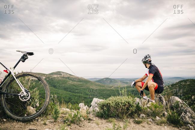 Mountain biker in extreme terrain, Tarragona, Spain