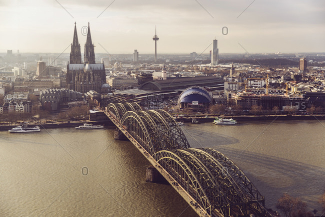View to skyline with Rhine River and Hohenzollern Bridge in the foreground, Cologne, Germany