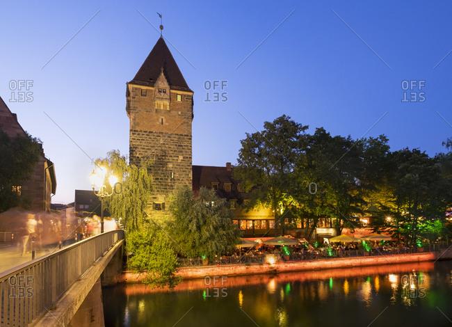 Nuremberg, Germany - August 27, 2015: Schuldturm and Restaurant Celona on island Schuett at Pegnitz River, Nuremberg