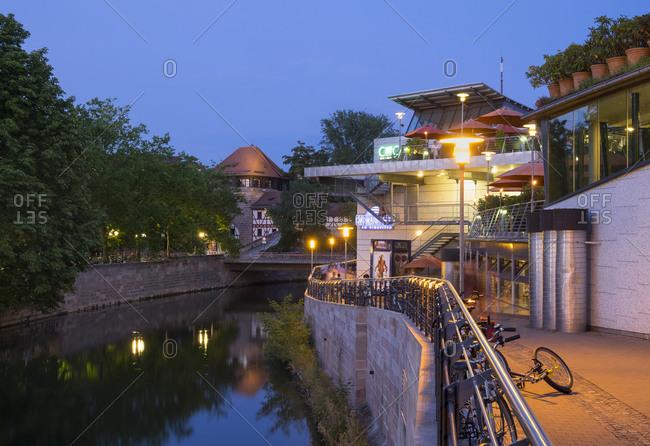 Nuremberg, Germany - August 27, 2015: Cinecitta cinema complex at Pegnitz River with Tratzenzwinger in background, Nuremberg