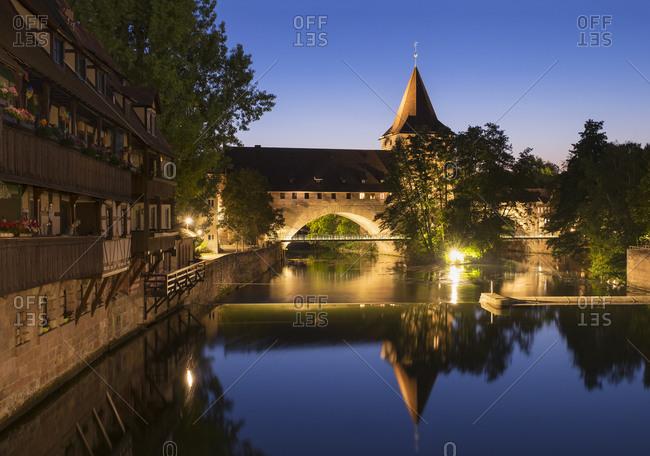 Nuremberg, Germany - August 27, 2015: Kettensteg and Fronveste with Schlayerturm at Pegnitz River, Nuremberg