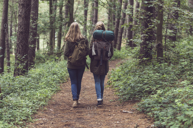 Two sisters walking together on a hiking trail