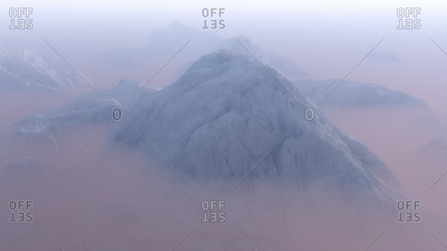 Mountain peak in morning mist