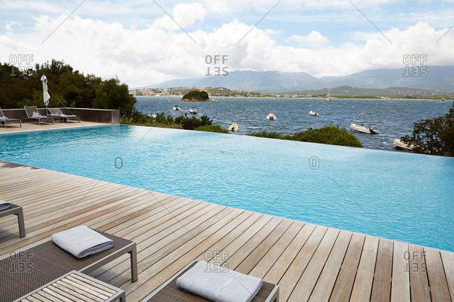 Porto Vecchio, Corsica, France - July 20, 2014: The infinity pool at hotel casa del mar in Porto Vecchio, Corsica, France
