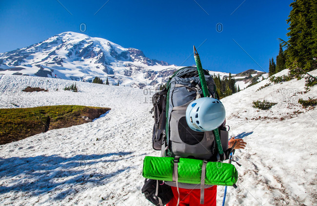 A climber begins to walk to the summit of Mount Rainier in Mount Rainier National Park, Washington, USA