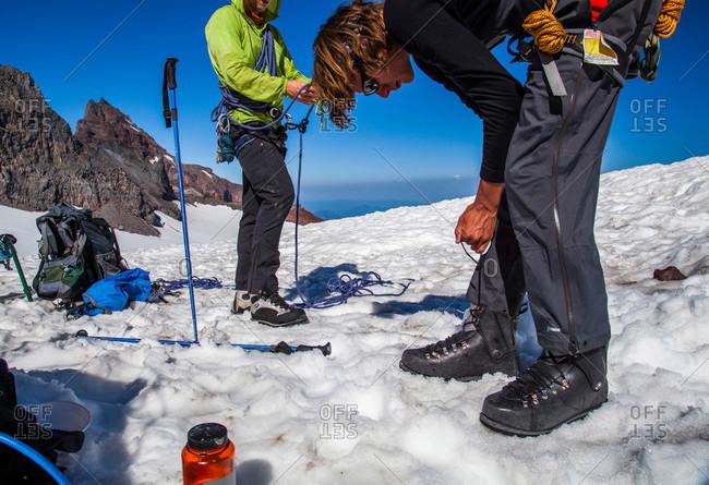 A climber prepares to climb to the summit of Mount Rainier in Mount Rainier National Park, Washington, USA
