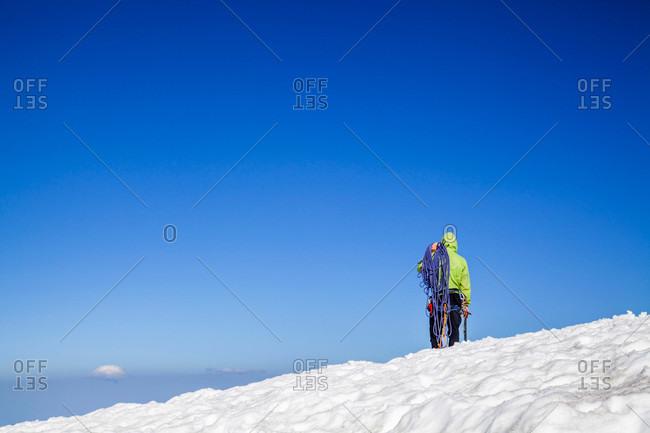 A climber ascends Mount Rainier in Mount Rainier National Park, Washington, USA