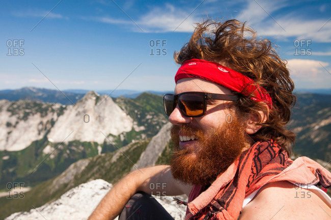 Climber and explorer, wearing a bandana and sporting a thick red beard