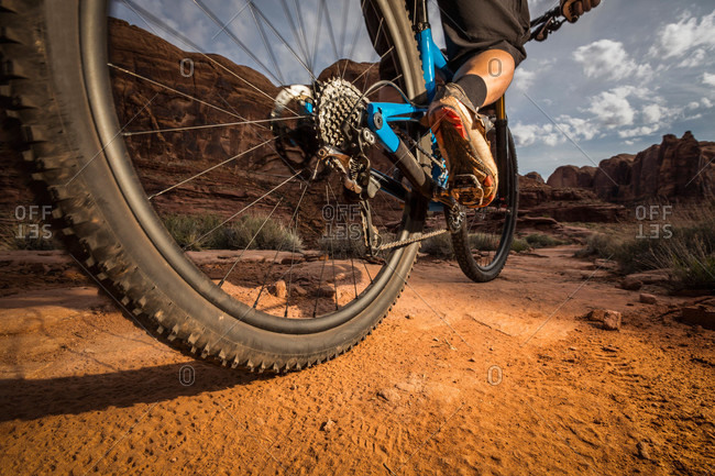 A man mountain biking on the Hymasa trail, Moab, Utah