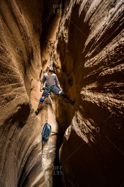 A man in East Fork White Roost Canyon, Robbers Roost area, Utah