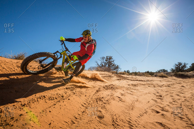 A man mountain biking, Moab, Utah