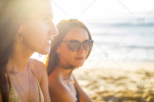 Portrait of two girls at sunset time